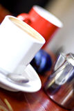 Coffee with milk. White coffee cup and saucer with steaming milk coffee Royalty Free Stock Photos