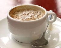 Coffee with milk. Spanish coffee with milk in white cup stock images