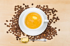 Coffee with milk and added butter.  royalty free stock photo