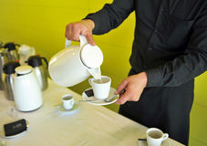 Coffee with milk, bartender, catering service Stock Photos