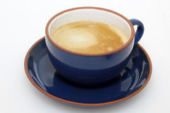 Coffee with milk in blue cup Royalty Free Stock Photography