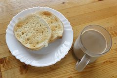 Coffee with milk and bread slices. Stock Photo
