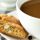 Coffee with milk and cantuccini Stock Images