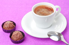Coffee and milk chocolate sweets with hazelnut Stock Photography
