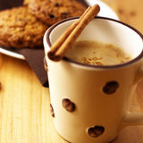Coffee with milk and cinnamon Stock Images