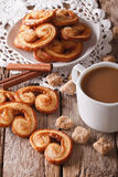 Coffee with milk and cookies Palmiers close-up. Vertical Stock Photos