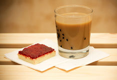 Coffee with milk and cranberry cake. On wooden table Stock Photo