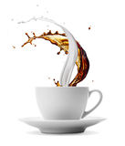 Coffee and milk. Cup of coffee and milk splashes isolated on white royalty free stock image