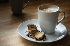 Coffee with milk foam and cocoa and marzipan in dark chocolate Stock Images