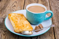 Coffee with milk, fresh pastry for breakfast. royalty free stock photo