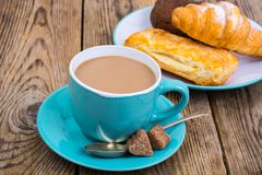 Coffee with milk, fresh pastry for breakfast. royalty free stock photography