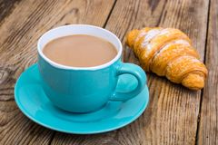 Coffee with milk, fresh pastry for breakfast. stock image
