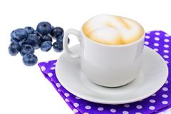 Coffee with milk and fresh ripe blueberries. Studio Photo Royalty Free Stock Images