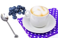 Coffee with milk and fresh ripe blueberries royalty free stock photo