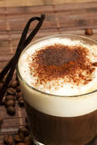 Coffee with milk froth, cocoa powder and standing Royalty Free Stock Photography
