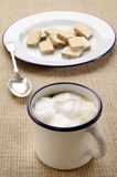 Coffee with milk froth in an enamel mug Royalty Free Stock Image