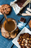 Coffee with milk in a glass with biscuits and chocolates, a top Royalty Free Stock Photography