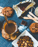 Coffee with milk in a glass with biscuits and chocolates, a top Royalty Free Stock Images