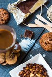 Coffee with milk in a glass with biscuits and chocolates, a top Royalty Free Stock Photos