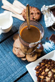 Coffee with milk in a glass with biscuits and chocolates, a top Stock Images