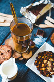 Coffee with milk in a glass with biscuits and chocolates, a top Stock Photography