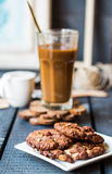 Coffee with milk in a glass with a chocolate chip cookie Royalty Free Stock Photo