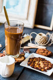 Coffee with milk in a glass with a chocolate chip cookie Royalty Free Stock Images