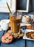 Coffee with milk in a glass with a chocolate chip cookie Royalty Free Stock Image