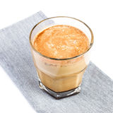 Coffee with milk  in a glass cup on linen tablecloth isolated on Stock Image