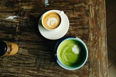Coffee with milk and green cream soup stock images