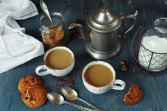 Coffee with milk and homemade oatmeal cookies Stock Photography