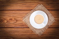 Coffee with milk on a napkin from a sacking Royalty Free Stock Photos