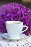 Coffee. With milk and purple flowers Stock Photo