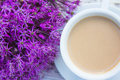 Coffee. With milk and purple flowers Royalty Free Stock Image