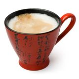 Coffee with milk in a red cup Royalty Free Stock Images