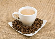 Coffee and milk and saucer with grains Stock Photography