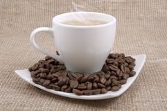 Coffee and milk and saucer with grains Royalty Free Stock Photography