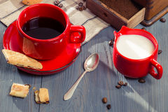 Coffee with milk served with cookie Royalty Free Stock Images