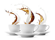 Coffee and milk. Three cups of coffee and milk splashing stock photos