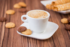 Coffee with milk in white cup Royalty Free Stock Photos