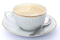 Coffee with milk in white and golden cup Royalty Free Stock Photography