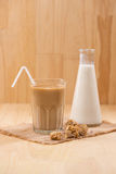 Coffee with milk on a wooden table. Royalty Free Stock Image