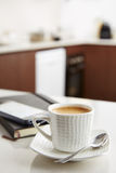 Coffee with milk at work Royalty Free Stock Images