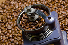Coffee mill. Detail of coffee mill with coffee beans Royalty Free Stock Photos