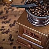 Coffee mill. Vintage coffee mill on wooden background stock image