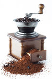 Coffee with mill. On white background Royalty Free Stock Images