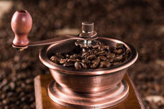 Coffee mill with aromatic coffee beans Stock Photo