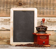Coffee mill and blank chalkboard Royalty Free Stock Photo