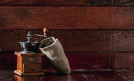 Coffee mill with burlap sack Stock Images