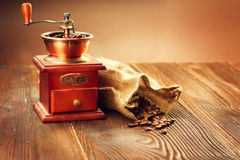 Coffee mill with burlap sack full of roasted coffee beans stock photo